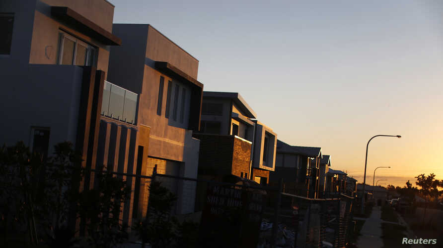 FILE - New million-dollar homes are pictured under construction at sunset in southern Sydney, Aug. 14, 2014. More wealthy Chinese are moving their money out of China to invest in Australia's property market.