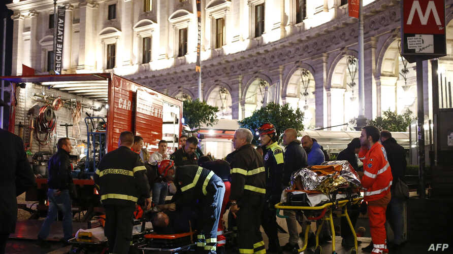 First responders evacuate wounded persons on Piazza della Repubblica in central Rome on Oct. 23, 2018, after at least 20 people were injured when an escalator leading to the Repubblica metro station collapsed.