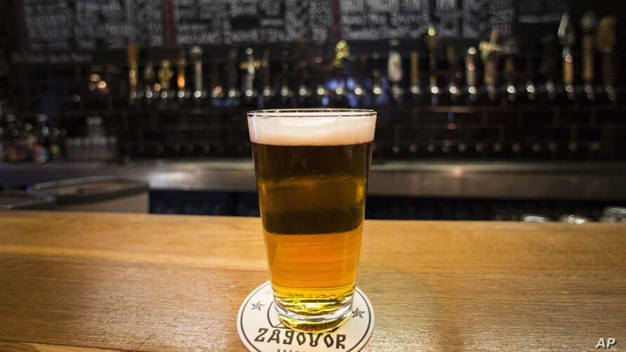 In this July 21, 2017 photo, a glass of craft beer sits on the bar at the RULE Taproom pub in Moscow, Russia. A new generation of craft beer brewers began sprouting in the vodka capital of the world as foreign beers got too expensive.