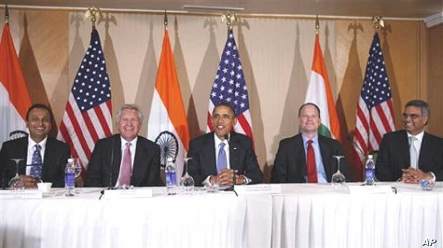 President Barack Obama seated with, from left to right, Anil Ambani of Reliance Anil Dhirubhai Ambani, General Electric's Jeffrey Immelt, Boeing's Christopher Chadwick, Bhupendra Khansagra of India's Spice Jet, as he holds a roundtable discussion wit