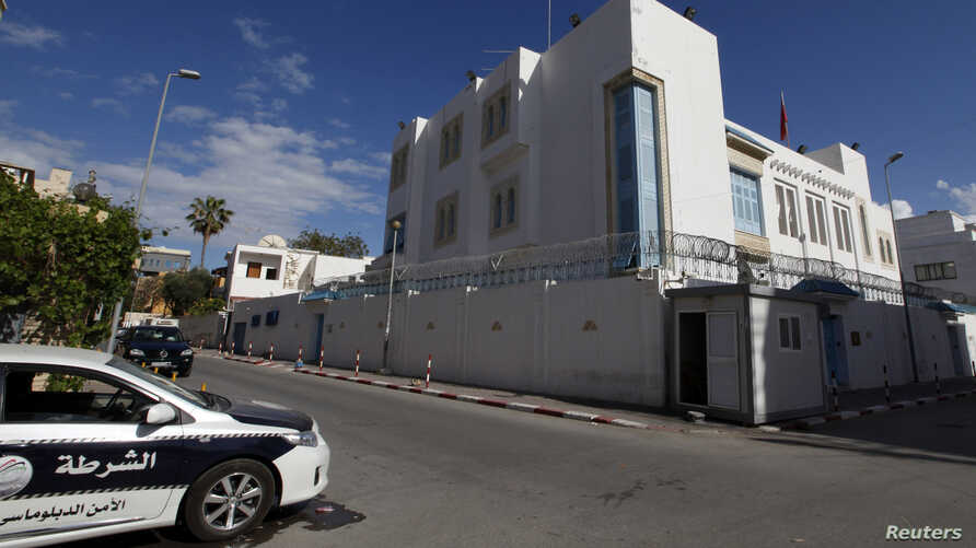 The police car is seen parked in front of the Tunisian embassy in Tripoli, Libya, April 17, 2014.