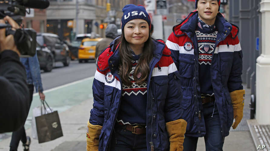 Ice dancing pair and sister and brother Maia and Alex Shibutani, who will participate in the upcoming winter Olympics in Pyeongchang, South Korea, model Team USA's opening ceremony uniforms.