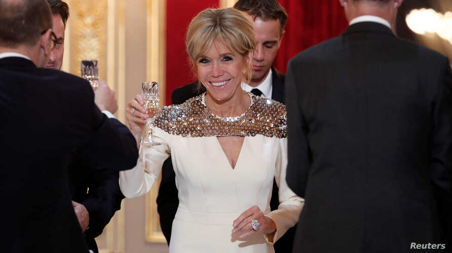 French First Lady Brigitte Macron attends a state dinner held at the Elysee Palace in Paris, France, March 19, 2018.