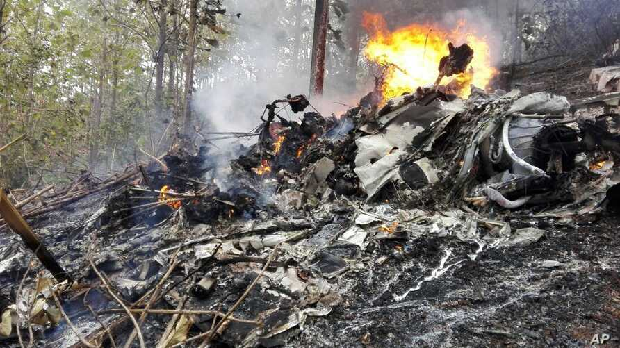 This photo released by Costa Rica's Civil Aviation press office shows the site of a plane crash in Punta Islita, Guanacaste, Costa Rica, Sunday, Dec. 31, 2017.