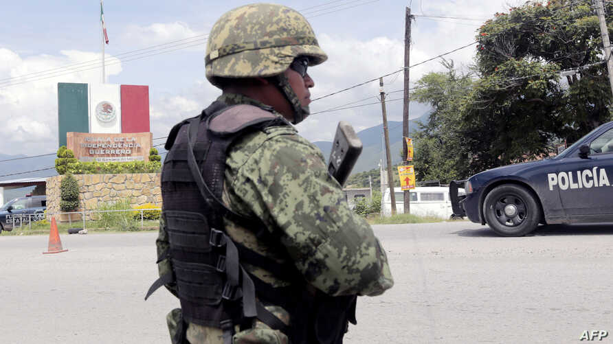 A Mexican soldier stands guard at a checkpoint in Iguala, Guerrero State, Mexico, Sept. 29, 2014, following recent clashes that led to at least six deaths.