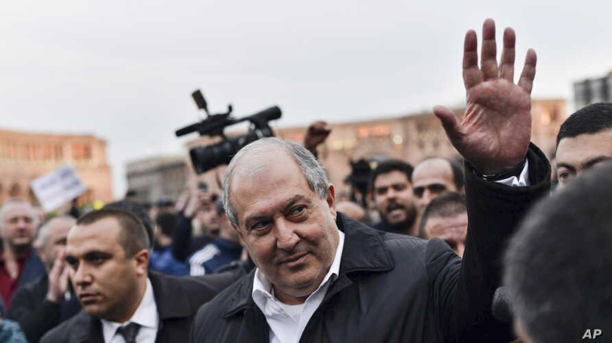 Armenian president Armen Sarkisian greets demonstrators in the Republic Square gathered to protest the former president's shift into the prime minister's seat in Yerevan, Armenia,  April 21, 2018.