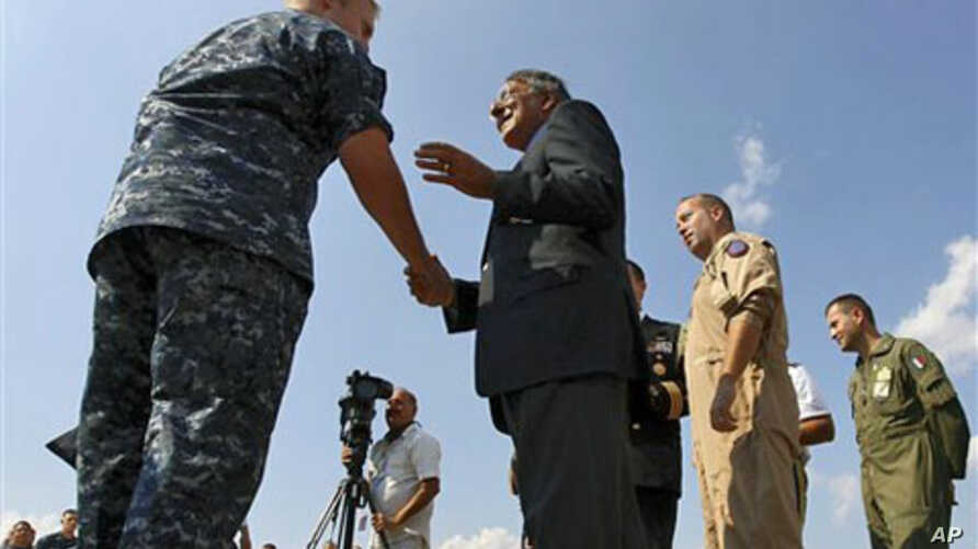 U.S. Defense Secretary Leon Panetta greets personnel while visiting the Sigonella Naval Air Station and NATO regional operations center, in Sigonella, Italy, October 7, 2011.