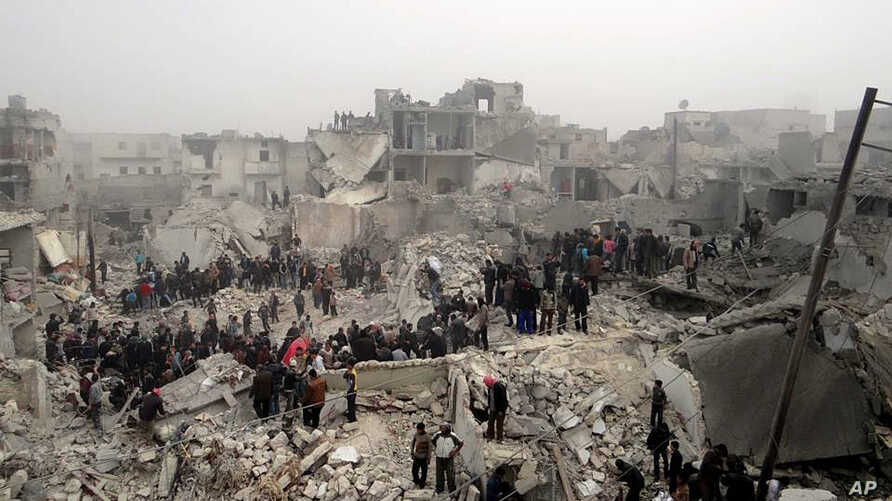 This citizen journalism image provided by Aleppo Media Center AMC shows people searching through the debris of destroyed buildings in the aftermath of a strike by Syrian government forces, in the neighborhood of Jabal Bedro, Aleppo, February 19, 2013