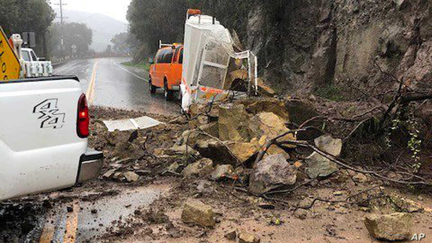 This photo provided by the California Department of Transportation (Caltrans) shows debris from a rock slide in the middle of Topanga Canyon Road in Los Angeles after a heavy rainstorm swept through Jan. 17, 2019.