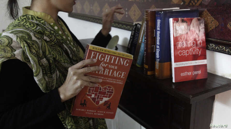 Maryam Suheyl, a marriage and family therapist, checks her books at  her office in Lahore January 6, 2013. Pakistani women are slowly turning to divorce to escape abusive and loveless marriages, once taboo and still a dangerous option in this strict