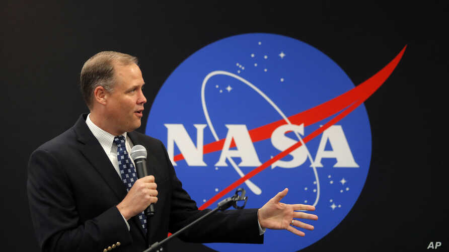FILE - NASA Administrator James Bridenstine delivers remarks as he tours the NASA Michoud Assembly Facility in New Orleans, Aug. 13, 2018.