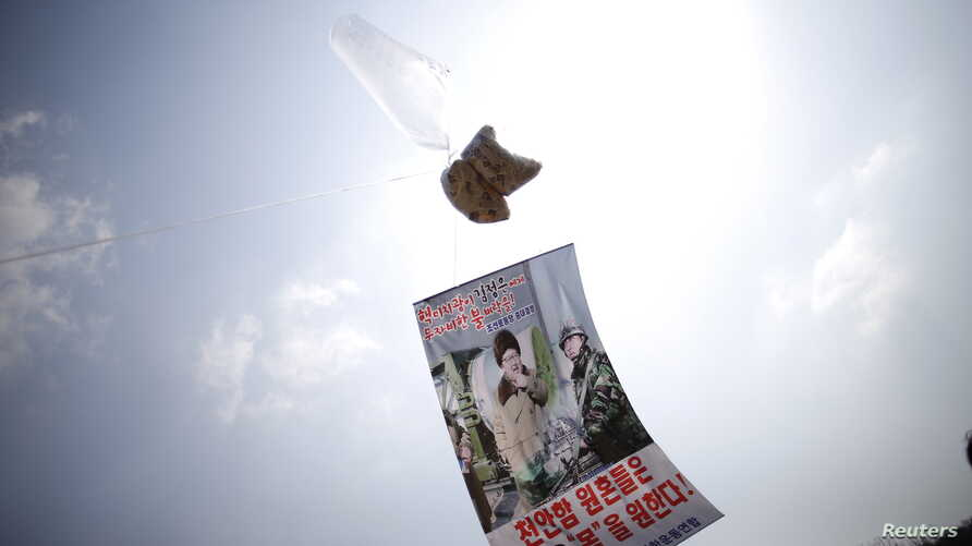 A balloon containing leaflets denouncing North Korean leader Kim Jong Un is seen near the demilitarized zone separating the two Koreas in Paju, South Korea, March 26, 2016, on the sixth anniversary of the sunken naval ship Cheonan. The lettering on t