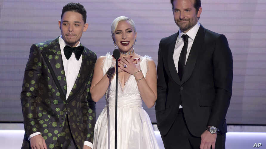 "Anthony Ramos, from left, Lady Gaga and Bradley Cooper, nominated for outstanding performance by a cast in a motion picture, introduce a clip from their film ""A Star Is Born"" at the 25th annual Screen Actors Guild Awards at the Shrine Auditorium & Ex"