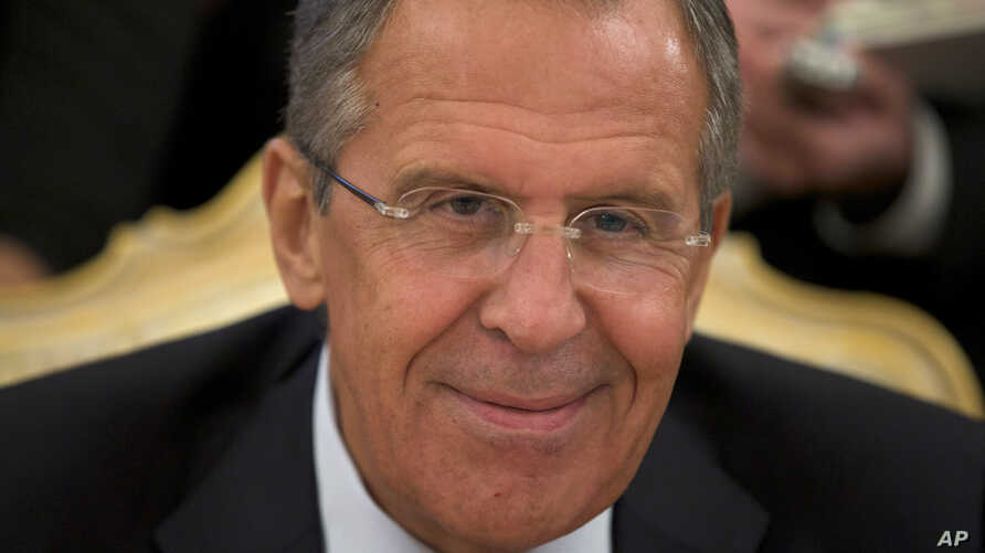 FILE - Russian Foreign Minister Sergey Lavrov smiles as he listens to his Egyptian counterpart, Nabil Fahmy, unseen, during talks in Moscow, Russia.