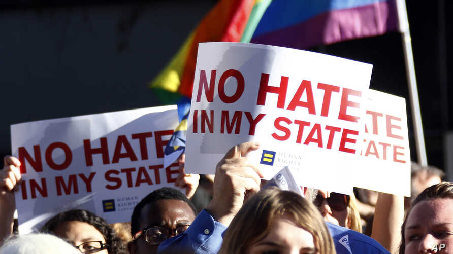 Protesters call for Mississippi Gov. Phil Bryant to veto House Bill 1523, which they say will allow discrimination against LGBT people, during a rally outside the Governor's Mansion in Jackson, Mississippi, April 4, 2016.