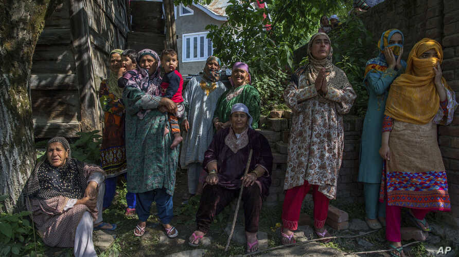 Kashmiri village women grieve as they watch the funeral procession of rebel leader Sabzar Ahmed Bhat in Retsuna 45 Kilometers south of Srinagar, Indian controlled Kashmir, May 28, 2017.
