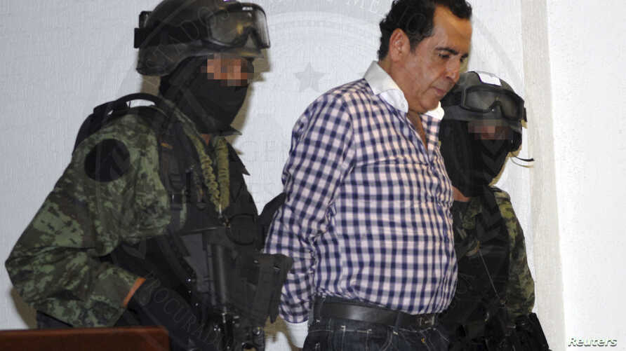 Soldiers escort head of the Beltran Leyva drug cartel Hector Beltran Leyva in Mexico City, in this handout picture taken Oct. 1, 2014 by the Attorney General's Office.