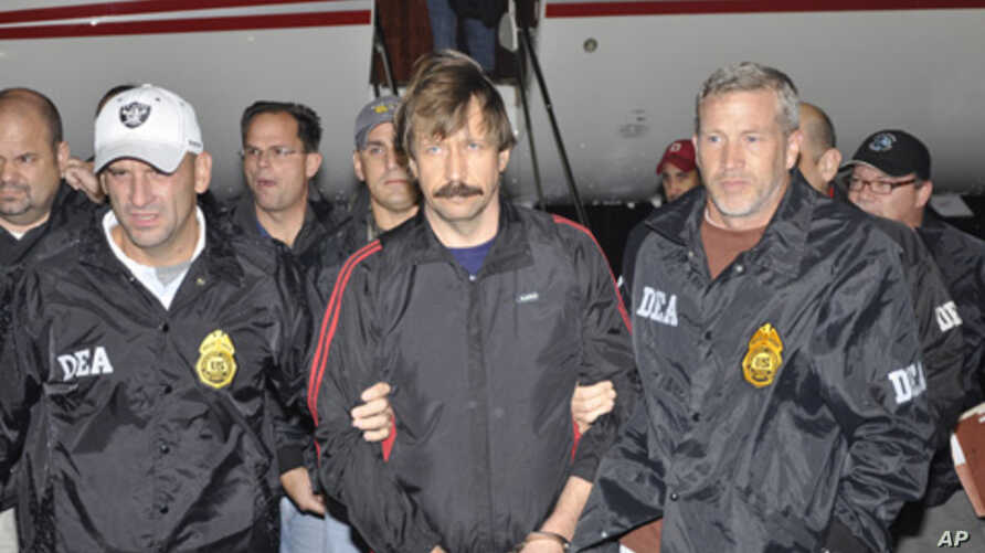 Suspected Russian arms dealer Viktor Bout (C) is escorted by Drug Enforcement Administration (DEA) officers after arriving at Westchester County Airport in White Plains, New York November 16, 2010.