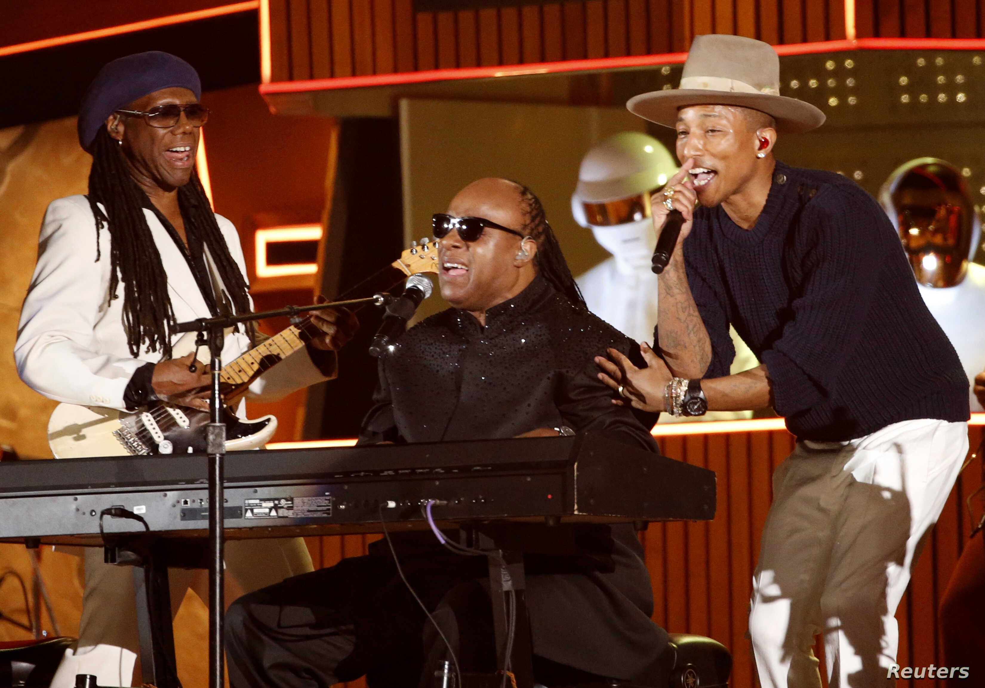 """Stevie Wonder (C) performs the Daft Punk's song """"Get Lucky"""" with Pharrell Williams and Nile Rodgers (L) at the 56th annual Grammy Awards in Los Angeles, Jan. 26, 2014"""