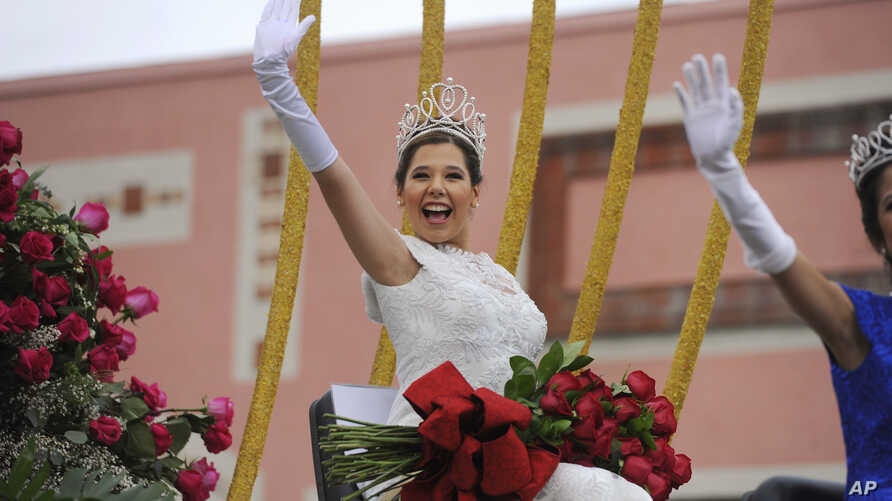 FILE - Rose Queen Victoria Castellanos waves to the crowd at the 128th Rose Parade in Pasadena, Calif., Jan. 2, 2017.