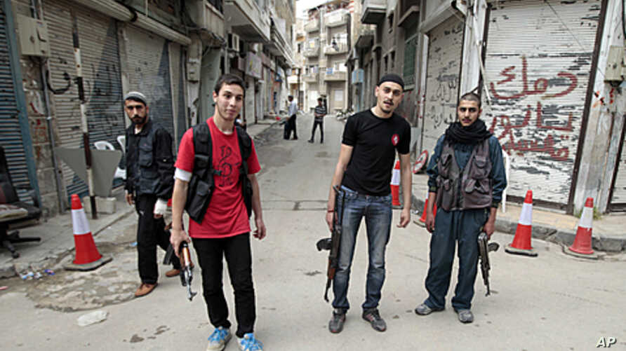 Syrian rebels stand in the Khalidiya district of the central Syrian city of Homs, May 3, 2012.