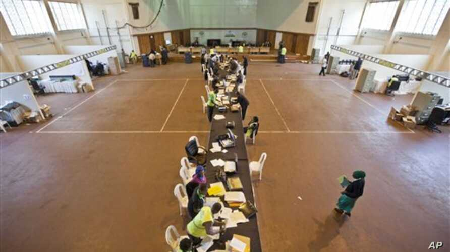 Electoral workers engage in vote tally verification process at National Tallying Center in Nairobi, Kenya March 6, 2013