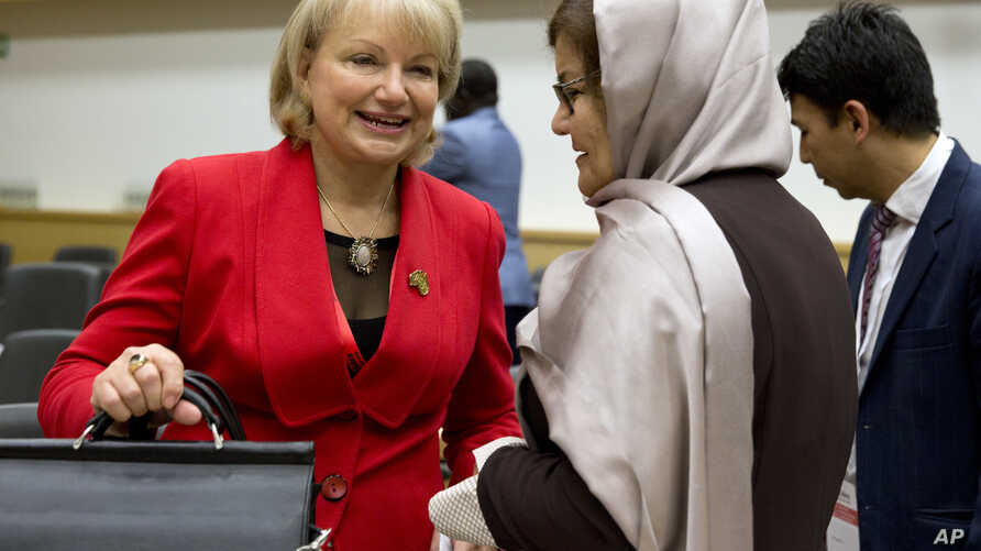 Australia's Ambassador for Women and Girls for the Department of Foreign Trade and Affairs, Sharman Stone, left, speaks with Afghanistan's Minister for Women's Affairs Alhaj Delbar Nazari as they attend the She Decides conference, at the Egmont Palac