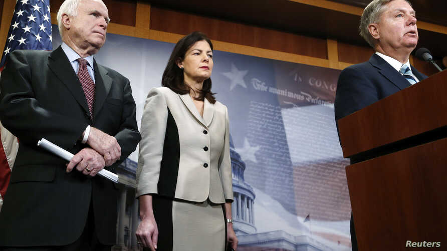 FILE - From left, Republican U.S. Senators John McCain or Arizona, Kelly Ayotte of New Hampshire and Lindsey Graham of South Carolina talk to reporters about legislation aimed at restricting prisoner transfers from the detention center at Guantanamo