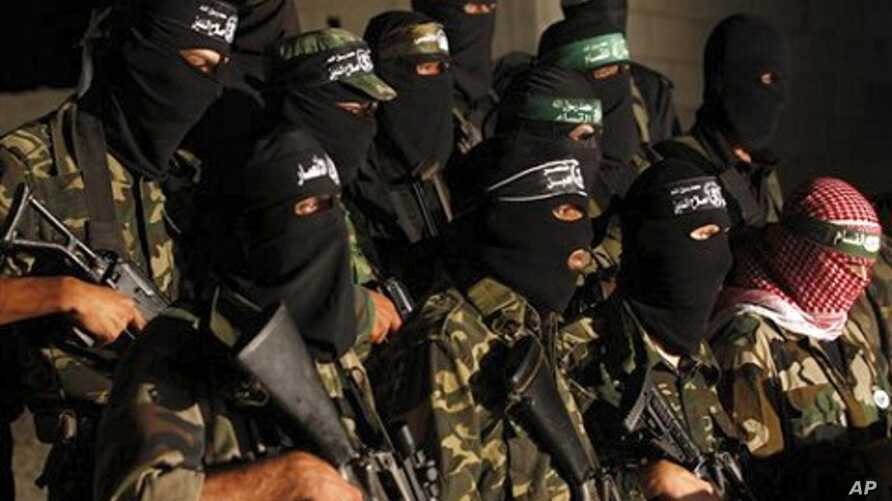 Masked Palestinian Hamas militants hold a press conference in Gaza City, 2 Sept. 2010.