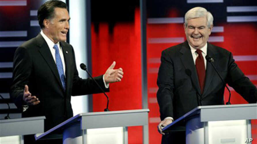 Republican presidential candidates Mitt Romney, left, Newt Gingrich, right, during the Republican debate, in Des Moines, Iowa, December 10, 2011.