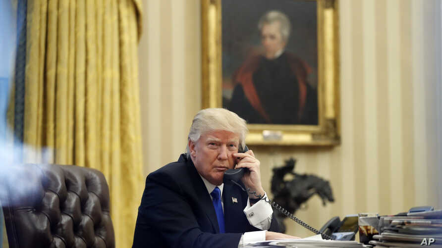 President Donald Trump speaks on the phone with Prime Minister of Australia Malcolm Turnbull in the Oval Office of the White House,  Jan. 28, 2017.