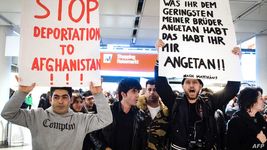 demonstration against the deportation of some 50 Afghan refugees  from Munich airport,