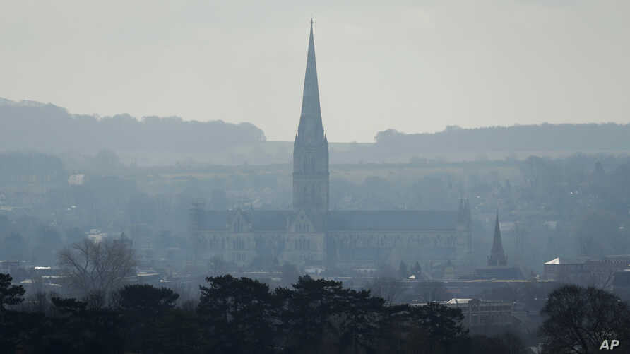 The combined tower and spire of Salisbury Cathedral stand surrounded by the medieval city where former Russian double agent Sergei Skripal and his daughter were found critically ill following exposure to the Russian-developed nerve agent Novichok in
