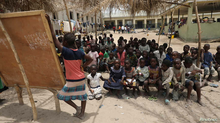 Children gather at a makeshift school at the IDPs Abagena camp in Benue, Nigeria, April 11, 2018.