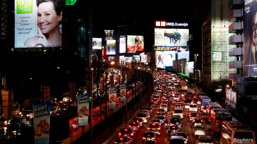 Vehicles queue in traffic along EDSA highway in Makati City, Philippines, Feb. 11, 2019.