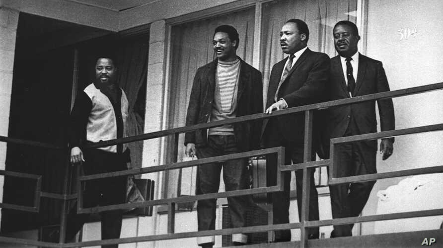The Rev. Martin Luther King Jr. stands with other civil rights leaders on the balcony of the Lorraine Motel in Memphis, Tenn., a day before he was assassinated at approximately the same place, April 3, 1968.