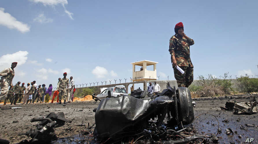 Somali security forces attend the scene after an attack on a European Union military convoy in the capital Mogadishu, Somalia, Oct. 1, 2018.