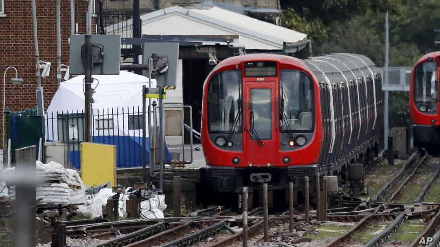 A police forensic tent stands on the platform next to the train on which a homemade bomb exploded at Parsons Green subway station in London, Sept. 15, 2017.