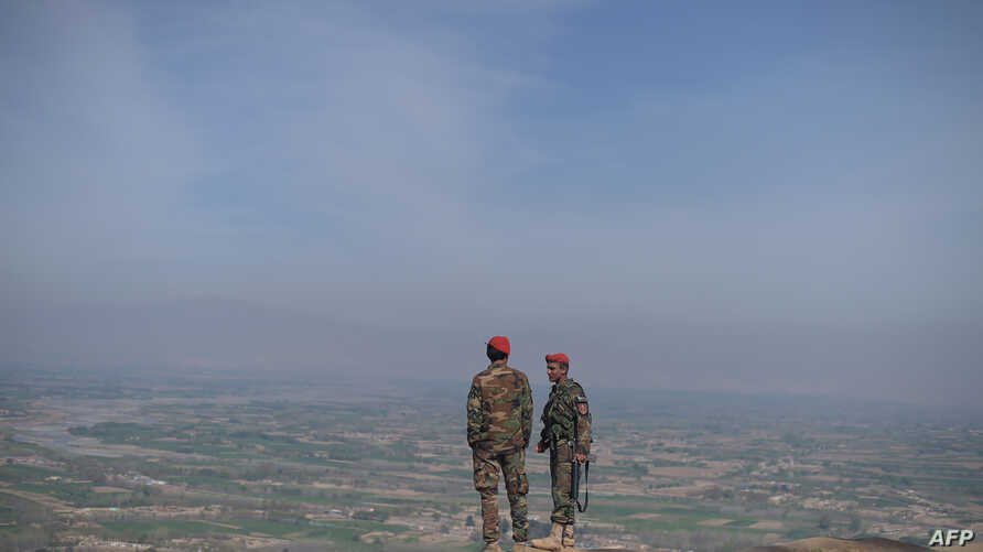 Afghan National Army (ANA) soldiers keep watch in Dand-e-Ghori district in Baghlan province on March 15, 2016, following weeks of heavy battles to recapture the area from Taliban militants.