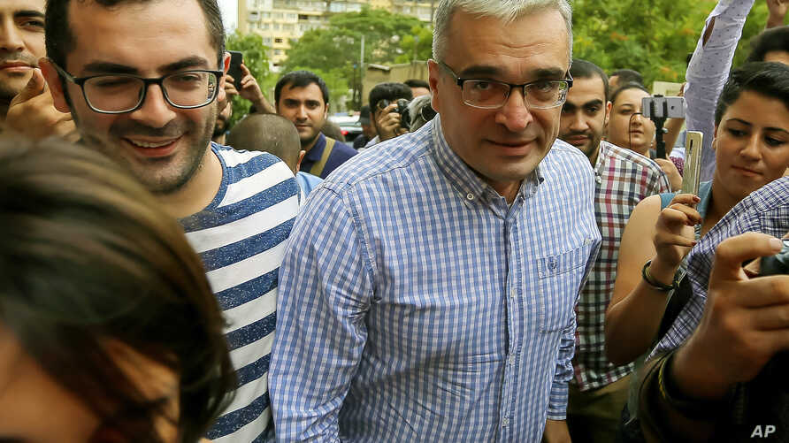 Ilgar Mammadov (C), the leader of the opposition REAL movement, walk with supporters after being released from a prison in Shaki, Azerbaijan, Aug. 13, 2018.