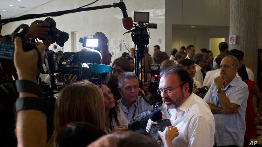 Mexican Foreign Minister Luis Videgaray, right, talks with journalists after the opening ceremony of the XXII Ordinary Meeting of the Council of Ministers of the the Association of Caribbean States at the Havana Libre Hotel in Havana, Cuba, March 10,