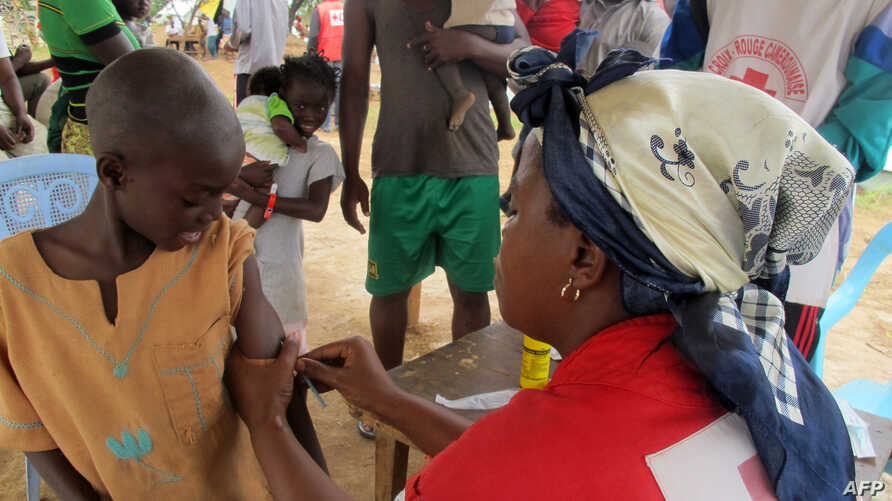 A child from the Central African Republic receives a measles vaccine in a refugee camp set up by the UNHCR in Nangungue, eastern Cameroon, on April 12, 2013.