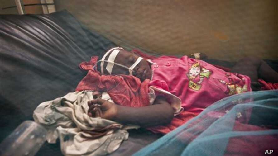 A Somali child with suspected meningitis lies in an isolation ward of the Benadir hospital in Mogadishu, Somalia Wednesday, April 24, 2013. Authorities in Somalia, which has one of the lowest immunization rates in the world, launched the deployment o