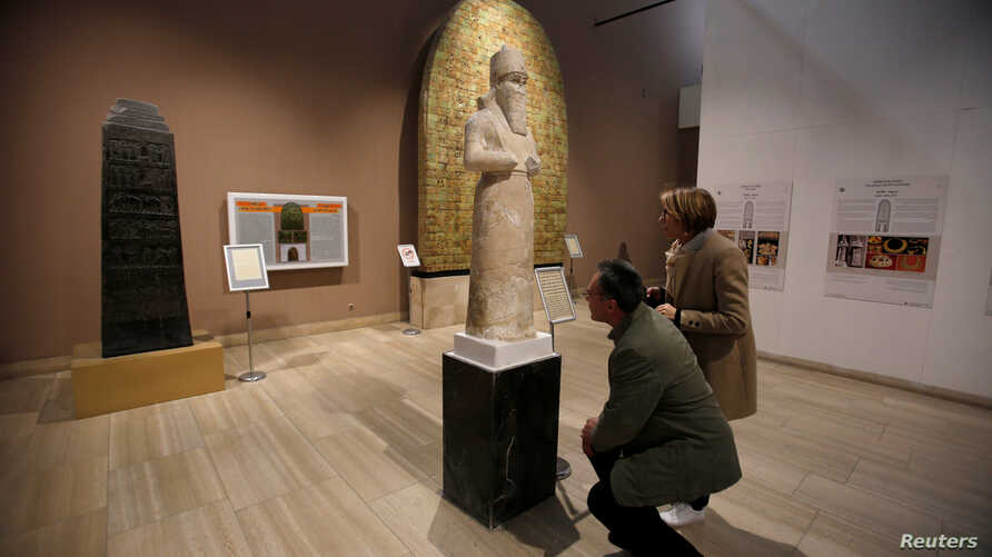 Participants in the Antiquities Protection Workshop look a King Shalmaneser III statue, while learning to counter heritage crimes and trafficking of artifacts, at the Iraqi National Museum in Baghdad, Iraq, Jan. 23, 2019.