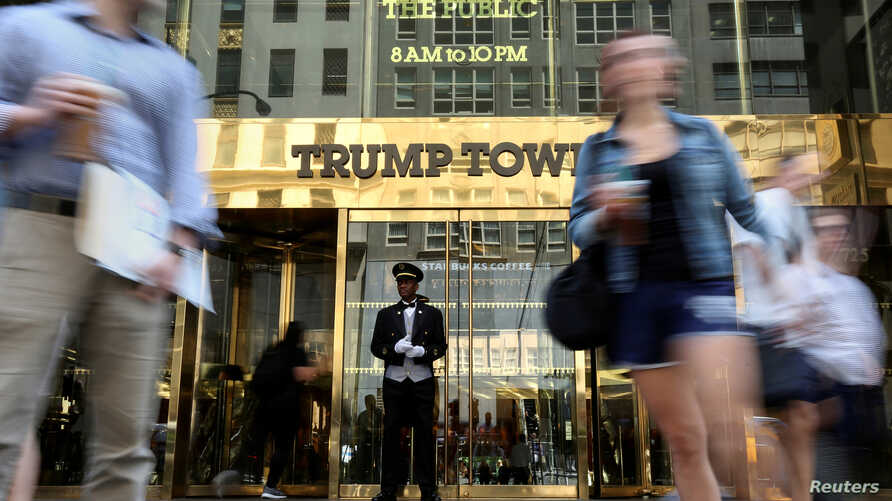 FILE - A doorman stands as people walk past the Trump Tower in New York, May 23, 2016.