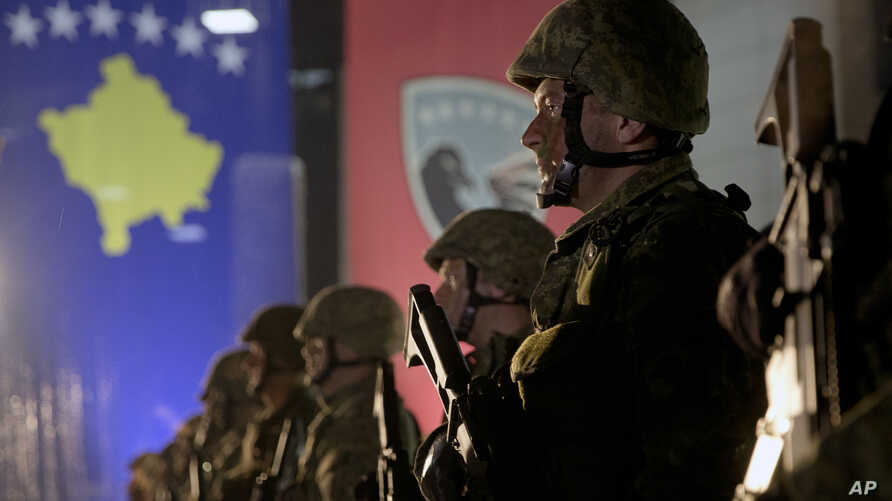 Soldiers of the Kosovo Security Force line up at the end of a formation ceremony in Pristina, Dec. 14, 2018. Kosovo's parliament convened Friday to approve the formation of an army.