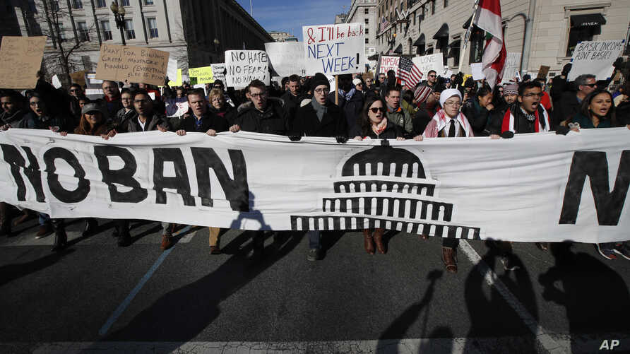 Protesters march from Lafayette Park near the White House in Washington, Feb. 4, 2017, during a rally protesting the immigration policies of President Donald Trump.