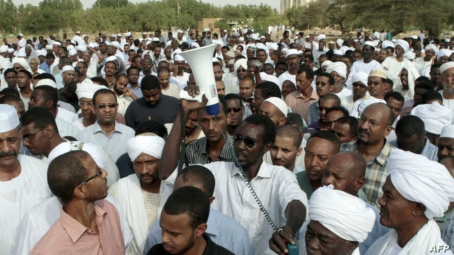 Family members and friends gather for the funeral of Salah Mudathir, 28, killed the day before in clashes following protests in the Sudanese capital Khartoum, Sept. 28, 2013.