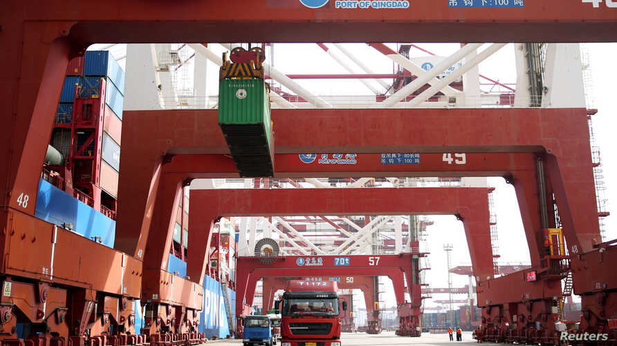 Trucks transport containers at a port in Qingdao, Shandong province, China, Apr. 8, 2018.