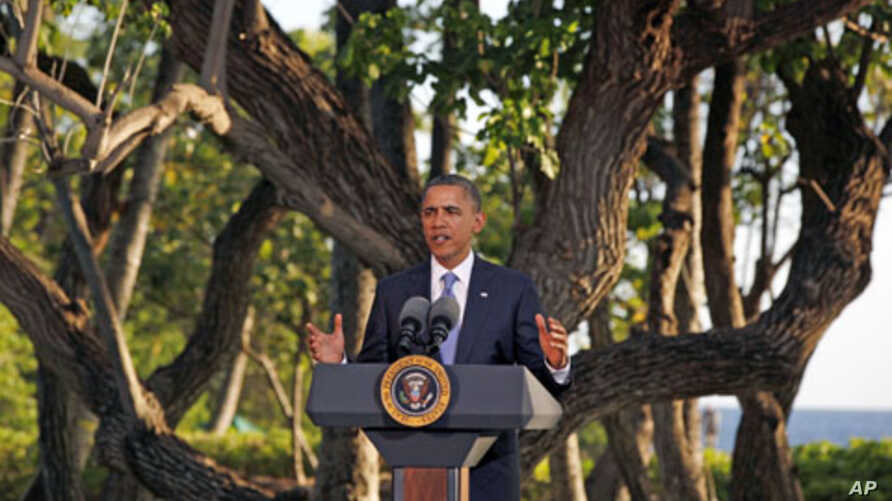 U.S. President Barack Obama speaks at his news conference at the conclusion of the APEC Summit in Honolulu, Hawaii, November 13, 2011.